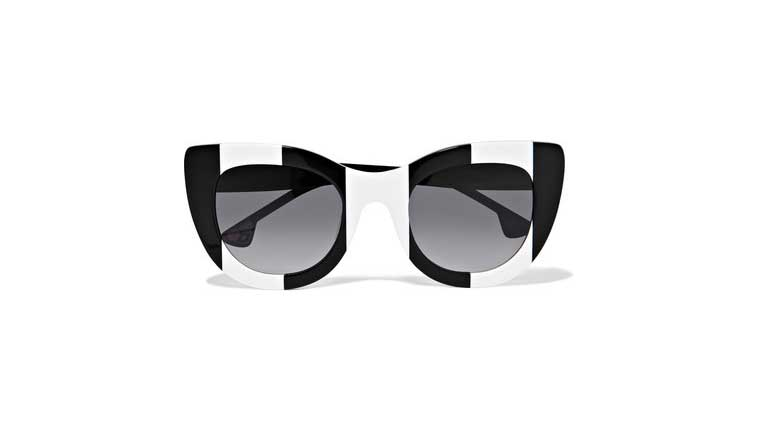 2bc9d505da6 This bold black and white striped pair is made from lightweight acetate  inlaid with custom-dyed gradient lenses - they re specially treated to  minimize ...